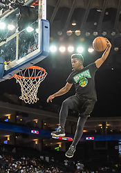 July 6, 2018 - Oakland, CA, U.S. - OAKLAND, CA - JULY 06: A stunt dunker sails toward the rim before game 4 in week three of the BIG3 3-on-3 basketball league on Friday, July 6, 2018 at the Oracle Arena in Oakland, CA (Photo by Douglas Stringer/Icon Sportswire) (Credit Image: © Douglas Stringer/Icon SMI via ZUMA Press)