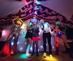 © Licensed to London News Pictures. 27/06/2015. Pilton, UK.  Night-time festival atmosphere at Glastonbury Festival 2015 in the Shangri-La area of the festival on Saturday Day 4 of the festival.  Shangri-La is a destroyed dystopian pleasure city.  This years headline acts include Kanye West, The Who and Florence and the Machine, the latter being upgraded in the bill to replace original headline act Foo Fighters. Photo credit: Richard Isaac/LNP