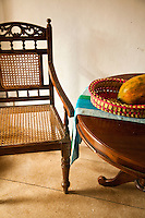 Wicker chair and papaya on the veranda of a colonial villa in Galle Fort, a preserved area of Galle, Sri Lanka and a UNESCO World Heritage Site.