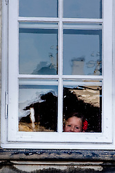 Princess Josephine looks through a window outside Amalienborg palace in Copenhagen, Denmark, on Tuesday August 15, 2017. Prince Vincent and Princess Josephine, both born in 2011, begin in grade 0 at Tranegard School in Hellerup on Tuesday. The twins are the youngest children of the crown princely couple. Photo by Robin Utrecht/ABACAPRESS.COM