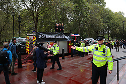 © Licensed to London News Pictures. 03/10/2019. London, UK. The scene at the Treasury in Westminster which has been sprayed in red paint by Extinction Rebellion activists . The stunt, which partly went wring, was intended to cover the building in red dye looking like blood. Photo credit: Rob Pinney/LNP