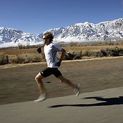 Olympic marathoner Ryan Hall trains for the Olympics at the base of the Eastern Sierra mountains. Model released.