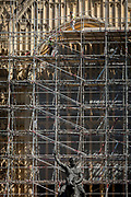 With the statue of King Richard the Lionheart (Richard Coeur de Lion) raising his sword, scaffolders lay boards high up on the exterior of the Palaces of Westminster, on 13th May, in London, England.