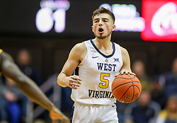 Nov 24, 2018; Morgantown, WV, USA; West Virginia Mountaineers guard Jordan McCabe (5) dribbles the ball up the floor during the second half against the Valparaiso Crusaders at WVU Coliseum. Mandatory Credit: Ben Queen-USA TODAY Sports