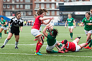 Lindsay Peat of Ireland dives past Robyn Wilkins of Wales (l) to score Ireland's first try of the match. <br /> RBS Womens Six Nations 2017 international rugby, Wales women v Ireland women at the BT Sport Cardiff Arms Park in Cardiff , South Wales on Saturday 11th March 2017.  pic by Simon Latham, Andrew Orchard sports photography