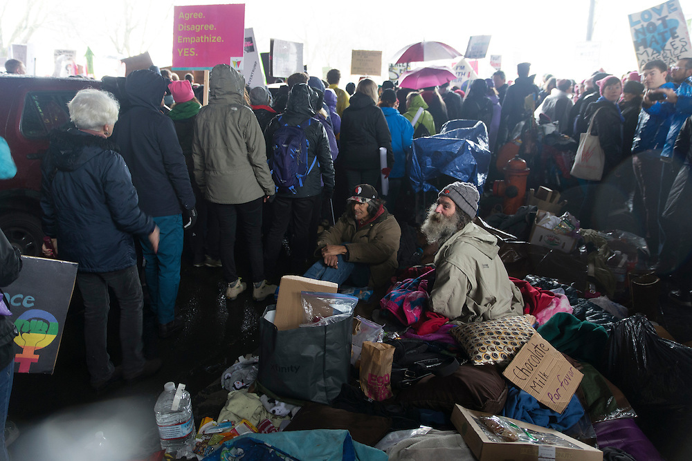 Part of the Women's March on Portland passed by a homeless camp under the Morrison Bridge in Portland, Ore. on Saturday, Jan. 21, 2016. The march was held in support of a national women's march held in Washington, D.C.  Photo by Randy L. Rasmussen, © 2017.