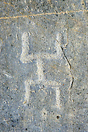 Petroglyph, rock carving, of what is known as a praying man carved by the Camunni people in the iron age between 1000-1600 BC, Rock no 1, Riserva Naturale Incisioni Rupestri di Ceto, Cimbergo e Paspardo, Capo di Ponti, Valcamonica (Val Camonica), Lombardy plain, Italy .<br /> <br /> Visit our PREHISTORY PHOTO COLLECTIONS for more   photos  to download or buy as prints https://funkystock.photoshelter.com/gallery-collection/Prehistoric-Neolithic-Sites-Art-Artefacts-Pictures-Photos/C0000tfxw63zrUT4<br /> If you prefer to buy from our ALAMY PHOTO LIBRARY  Collection visit : https://www.alamy.com/portfolio/paul-williams-funkystock/valcamonica-rock-art.html