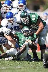 15 September 2007:  A run by Marcus Dunlop ends beneath a end of Lions.  The Titans stood toe to toe with the 25th ranked Lions through the first half but ended the game on the losing end of a 25-15 score at Wilder Field on the campus of Illinois Wesleyan University in Bloomington Illinois.