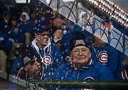 """""""Ushers on a Rainy Day."""" Chicago Cubs opening day Friday, April 4, 2014 at Wrigley Field. Made with three exposures in-camera. (Brian Cassella/Chicago Tribune) B583641656Z.1 <br /> ....OUTSIDE TRIBUNE CO.- NO MAGS,  NO SALES, NO INTERNET, NO TV, CHICAGO OUT, NO DIGITAL MANIPULATION..."""