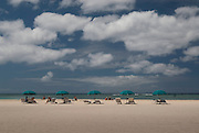 Beach chairs and umbrellas on Waikiki Beach in Hawaii.