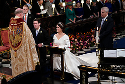 The Duke of York (right) stands next to his daughter Princess Eugenie and her groom Jack Brooksbank and his best man, his brother Thomas, as the Dean of Windsor Revd David Conner, conducts their wedding ceremony at St George's Chapel in Windsor Castle.
