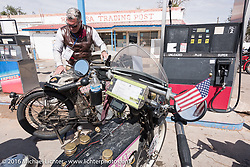 Dean Bordigioni of California gases up his Class-1 single-cylinder single-speed 1914 Harley-Davidson at the Mesa Trading Post in Arizona during the Motorcycle Cannonball Race of the Century. Stage-11 ride from Durango, CO to Page, AZ. USA. Wednesday September 21, 2016. Photography ©2016 Michael Lichter.