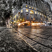 Sitting on the curb near the New York Stock Exchange to tie my shoes and rest for a minute