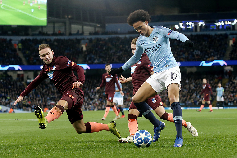 Manchester City's Leroy Sane is tackled by 1899 Hoffenheim's Pavel Kaderabek<br /> <br /> Photographer Rich Linley/CameraSport<br /> <br /> UEFA Champions League Group F - Manchester City v TSG 1899 Hoffenheim - Wednesday 12th December 2018 - The Etihad - Manchester<br />  <br /> World Copyright © 2018 CameraSport. All rights reserved. 43 Linden Ave. Countesthorpe. Leicester. England. LE8 5PG - Tel: +44 (0) 116 277 4147 - admin@camerasport.com - www.camerasport.com