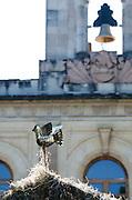 The dove on top of a nativity scene in Oaxaca's Zocalo, and the bell in the Palacio de Gobierno. (Mexico)