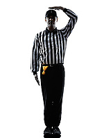 american football referee gestures uncatchable pass in silhouette on white background