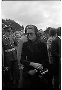 Funeral of Eamon DeValera.   (J72)..1975..02.09.1975..09.02.1975..2nd September 1975..Today saw the funeral of Eamon DeValera. He was laid to rest beside his wife Sinead in Glasnevin Cemetery,Dublin. Dignitries from all around the world attended at the funeral...Picture of Princess Grace of Monaco leaving the graveside after the ceremony.