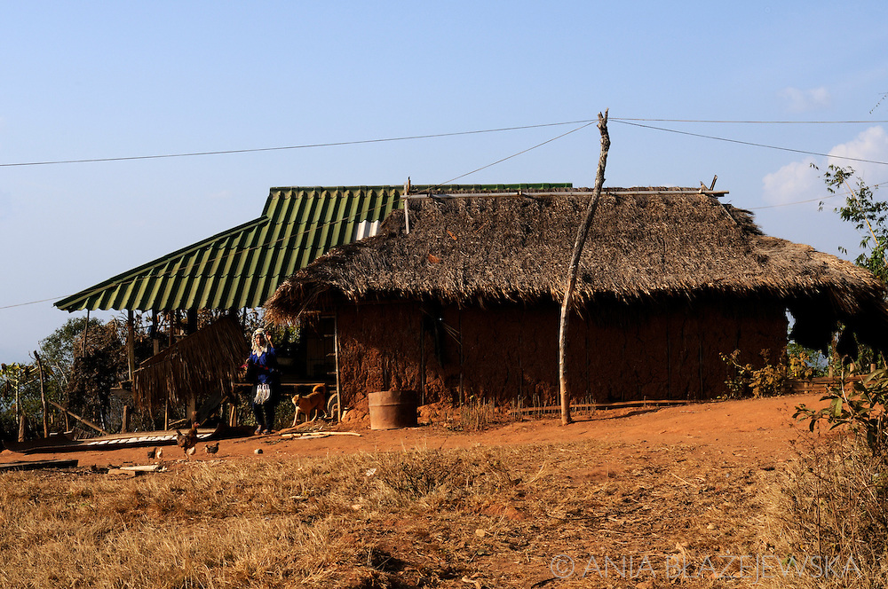 Burma, Myanmar. Traditional and modern houses in a village of the Akha hilltribe.