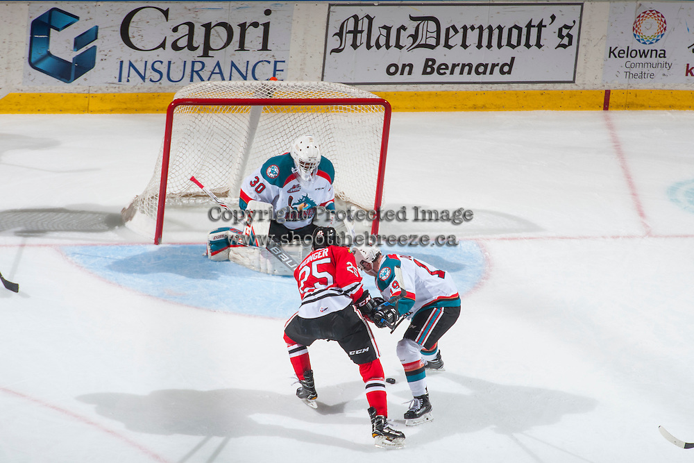 KELOWNA, CANADA - JANUARY 28: Evan Weinger #25 of the Portland Winterhawks is checked by Dillon Dube #19 in front of the net of Michael Herringer #30 of the Kelowna Rockets on January 28, 2017 at Prospera Place in Kelowna, British Columbia, Canada.  (Photo by Marissa Baecker/Shoot the Breeze)  *** Local Caption ***