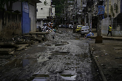 April 29, 2019 - Rio De Janeiro, Brazil - RIO DE JANEIRO, RJ - 29.04.2019: RUA ESBURACADA NA COMUNIDADE DA MUZEMA - Rua da Muzema, near the town of the condominium Figueiras do Itanhangá, completely baked on Monday (29). The region is known for the collapse of two irregular buildings that on April 12 killed 24 people. The lack of urban infrastructure and basic sanitation is a constant in the region. (Credit Image: © Roberto Herrera/Fotoarena via ZUMA Press)