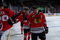 KELOWNA, BC - FEBRUARY 8: Jaydon Dureau #22 and Johnny Ludvig #15 of the Portland Winterhawks celebrates a second period goal with fist bumps past the bench against the Kelowna Rockets at Prospera Place on February 8, 2020 in Kelowna, Canada. Ludvig was seleced in the 2019 NHL entry draft by the Florida Panthers. (Photo by Marissa Baecker/Shoot the Breeze)