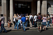 Crowd gather and queue up to enter the popular Abercrombie and Fitch store near Bond Street, central London.