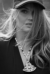 """Princess Diana's niece Lady Kitty Spencer looks like a million dollars in Bvlgari jewels after being snapped up as new ambassador for the luxury Italian brand. The 27-year-old model is following in her aunty's fashionable footsteps and has picked up a string of modeling gigs of late, with industry experts estimating her new deal with Bvlgari could be in the region of £1 million ($1.3 million USD). Earlier this year Kitty, who was just six years old when Princess Diana died in a car crash, starred in her first modeling campaign with Dolce & Gabbana and walked the runway for the brand's Spring/ Summer 2018 collection in March. The new Bvlgari deal now represents a jewel in the crown, quite literally, for the aspiring model, whose recent appearance at the royal wedding of Prince Harry and Meghan Markle raised her profile further with her turn in a stunning green floral D&G dress, teamed with orange heels and a green fascinator. The British aristocrat, who was raised in South Africa as a child before returning to the UK to study, is the daughter of Diana's younger brother Earl Spencer. Speaking about her new partnership with Bvlgari, Kitty said: """"It is an immense honor to be working with the most iconic Italian jewelry brand in the world. """"Bvlgari has always been synonymous with creativity, heritage, beauty and glamour. I am, therefore, very excited to be part of the Bulgari family, as it means experiencing their passion and magic first-hand."""" Since joining the brand, Kitty has been instrumental in helping raise funds for Bvlgari's key charity partners including the Elton John Aids Foundation (EJAF) and Save the Children. Last June, Kitty helped raise £140,000 for the EJAF, when she modeled and introduced the Bvlgari Divas' Dream full pave diamond necklace that was auctioned at their gala in aid for EJAF. Kitty is also hoping to visit some of Save the Children's UK programs later this year, which are supporting young children living in poverty by"""