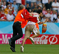 Photo: Glyn Thomas.<br />Tunisia v Saudi Arabia. Group H, FIFA World Cup 2006. 14/06/2006.<br /> A Tunisian fan runs onto the pitch just before the second half, but is apprehended by a steward.