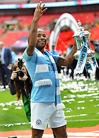 Football - 2019 Emirates FA Cup Final - Manchester City vs. Watford<br /> <br /> Manchester City's Raheem Sterling holds up three fingers with the trophy, at Wembley Stadium.<br /> <br /> COLORSPORT/ANDREW COWIE