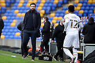 Milton Keynes Dons manager Russell Martin about to talk to Milton Keynes Dons defender Ethan Laird (12) during the EFL Sky Bet League 1 match between AFC Wimbledon and Milton Keynes Dons at Plough Lane, London, United Kingdom on 30 January 2021.