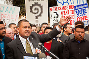 23 JANUARY 2012 - PHOENIX, AZ:     State Sen Steve Gallardo (CQ) talks about the damage SB 1070 to the state's reputation during a press conference at the State Capitol Monday, Jan 23. Both sides of the immigration debate congregated on the capitol grounds to protest against and in favor of SB 1070 and other anti immigration bills. At the same time people were protesting, legislators from both sides of the issue held press conferences.    PHOTO BY JACK KURTZ