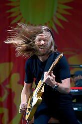 03 May 2013. New Orleans, Louisiana,  USA. .New Orleans Jazz and Heritage Festival. Maroon 5..James Valentine rocks JazzFest to the delight of a mud spattered crowd. .Photo; Charlie Varley.