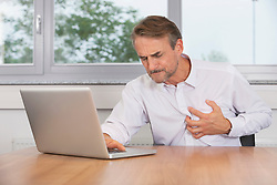Man office stress heart attack burnout anxiety