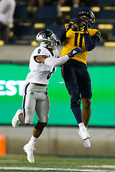 California wide receiver Kekoa Crawford (11) makes the catch of a pass in front of Nevada defensive back Berdale Robins (0) during the third quarter of an NCAA college football game, Saturday, Sept. 4, 2021, in Berkeley, Calif. (AP Photo/D. Ross Cameron)