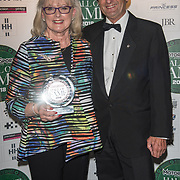 Pauline Hailwood and Graham Stewart receives Motor Cycles award for Mike Hailwood at The Motor Sport Hall of Fame will return to the spectacular Royal Automobile Club at Woodcote Park, Surrey, London, UK. 4 June 2018.