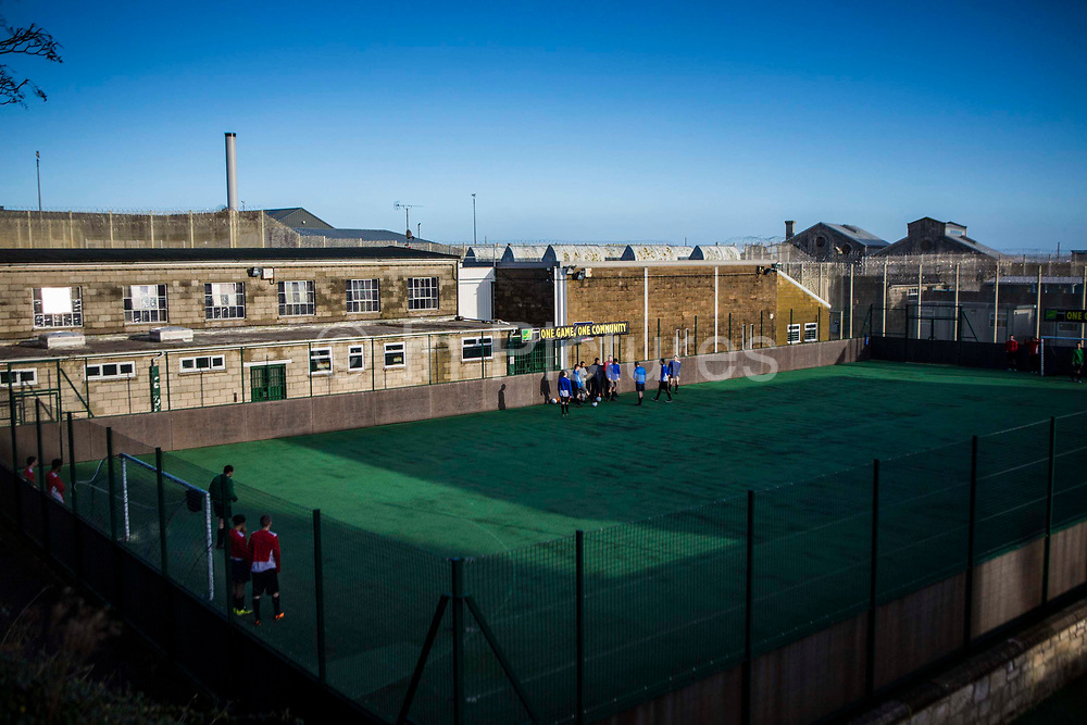 The prison astro turf football pitch HMP/YOI Portland, a resettlement prison with a capacity for 530 prisoners. Dorset, United Kingdom.