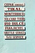 Local service signs in Antigua, a UNESCO World Heritage Site in Guatemala