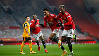 Football - 2020 / 2021 Premier League - Manchester United  vs Wolverhampton Wanderers - Old Trafford<br /> <br /> Marcus Rashford and Paul Pogba of Manchester United celebrate the winning goal at Old Trafford <br /> <br /> Credit COLORSPORT/LYNNE CAMERON