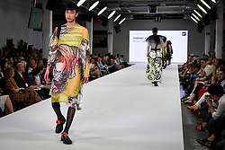 © Licensed to London News Pictures. 03/06/2018. LONDON, UK.  A model presents a look by Gwenny Von Quint from Plymouth College of Art on the opening day of Graduate Fashion Week taking place at the Old Truman Brewery in East London.  The event presents the graduation show of up and coming fashion designers from UK and international universities.  Photo credit: Stephen Chung/LNP