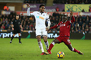 Leroy Fer of Swansea city is challenged by Sadio Mane of Liverpool (r). Premier league match, Swansea city v Liverpool at the Liberty Stadium in Swansea, South Wales on Monday 22nd January 2018. <br /> pic by  Andrew Orchard, Andrew Orchard sports photography.