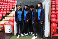 AFC Wimbledon defender Tennai Watson (2), AFC Wimbledon defender Paul Kalambayi (30), AFC Wimbledon midfielder Tyler Burey (32) and AFC Wimbledon defender Toby Sibbick (20) stood in the tunnel during the EFL Sky Bet League 1 match between Charlton Athletic and AFC Wimbledon at The Valley, London, England on 15 December 2018.