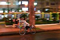 Street vendors riding around the bustling city of Saigon.