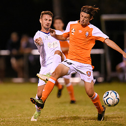BRISBANE, AUSTRALIA - FEBRUARY 10: James Coutts of United and Oliver Duncan of the Roar compete for the ball during the NPL Queensland Senior Mens Round 2 match between Gold Coast United and Brisbane Roar Youth at Station Reserve on February 10, 2018 in Brisbane, Australia. (Photo by Football Click / Patrick Kearney)