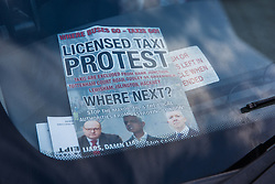 London, UK. 11th February, 2019. Licensed taxi drivers, or black cab drivers, block Parliament Square as part of a protest against taxis being excluded from Bank Junction, Tottenham Court Road, Tooley Street and areas of Greenwich, Lewisham, Islington and Hackney.