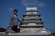 """VIDEO AVAILABLE - JAPAN OUT<br /> Huge miniature castle built by ONE MAN<br /> <br /> In Mie Precture, Japan, stands a 1/23 sized Miniature Himeji Castle. As many castle fans know the real Himeji Castle is known as a World Heritage Site and National Treasure. """"The Lord of the Castle"""" as we call him, Hiroyasu Imura (78 years old), says he built a small replica of Himeji Castle when he was in 8th grade, and that memory stuck with him, leading him to make a bigger castle as an adult. He remembered his childhood dream when his wife gave him a book about Himeji Castle for his 47th birthday. Then, he started studying architecture at the library and visited the real Himeji Castle many times. In 1989, he finally started construction on his own Himeji Castle.<br /> <br /> As he studied, he learned how to use concrete, bolts, nuts, fiber reinforced plastics(FRP), and other materials necessary to build a high quality replica. Throughout the process he worked hard to realize the smallest of details so as to make it as close to the real thing as possible. Not only are the proportions completely accurate, but even the number of stairs are exactly the same as the real castle. He even went above and beyond to replicate the trees and moss around the castle, adding samurai and animal dolls as well, in order to create a life-like atmosphere. Mrs. Imura took a pottery lesson to make the dolls.<br /> <br /> He finished the castle in March, 2007. It cost him 18 million yen and took 19 years in all to build.<br /> <br /> This castle, built by the romanticism of one man, still amazes and enchants onlookers years after its creation.<br /> ©Exclusivepix Media"""