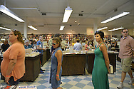 Huntington, New York, U.S. - August 6, 2014 - People wait on long lines inside the Book Revue at the book signing for the H. Clinton new memoir, Hard Choices, in Huntington, Long Island.