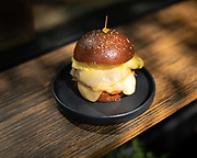 Brooklyn, NY - August 8, 2019: The Egg and Cheese Sandwich with Sausage at Sunday In Brooklyn in Williamsburg.<br /> <br /> Photo by Clay Williams for Serious Eats.<br /> <br /> © Clay Williams / http://claywilliamsphoto.com