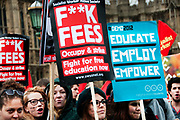 November 21st. Westminster. Demonstration organised by National Union of Students (NUS) against education cuts. Students from Sussex University hold placards saying 'F**k fees' and 'Demo2012. Educate, Employ, Empower'.