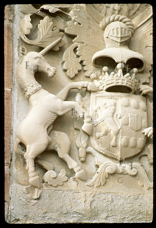 Royal coat of arms of resident Strathmore family is carved above front door of Glamis Castle, Queen Mum's girlhood home; Scotland