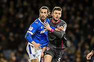 Portsmouth Defender, Christian Burgess (6) tries to get away from Morecambe Defender, Ryan Edwards (5) during the EFL Sky Bet League 2 match between Portsmouth and Morecambe at Fratton Park, Portsmouth, England on 28 February 2017. Photo by Adam Rivers.